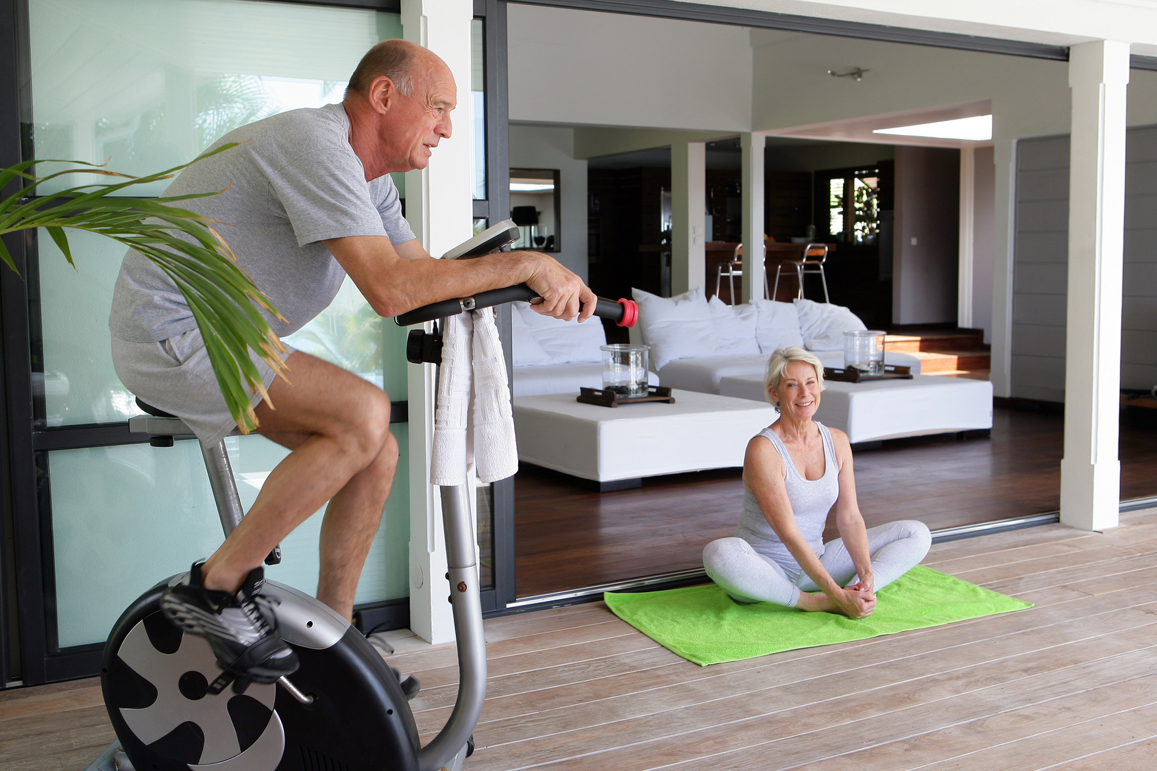 Elderly couple working out at home